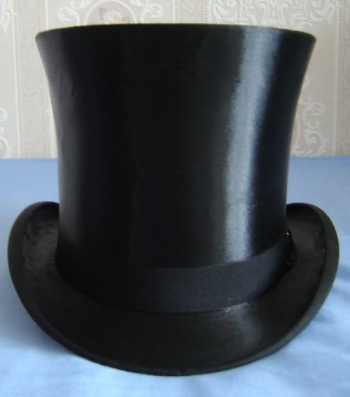 A vintage silk top hat made by H. P. Truefitt belonging to the author. This  has a  full bell crown  which has a distinctive wide tip and a suppressed  waist. 22c6d8907fdd
